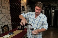 Vranac wine maker in his cellar - Skadar Lake, Montenegro