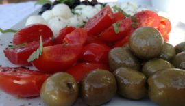 organic lunch of olives, tomatoes and mozzarella