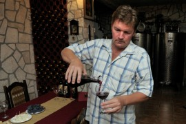 Vranac wine maker in his cellar - Skadar Lake, Montenegro