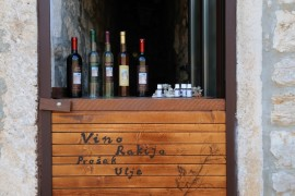 Stall selling wines, olive oil and grappa in Croatia